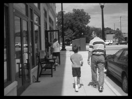 father and son walking by clonedmonkey