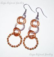 Silver and Copper Twisted hoop earrings by Toxic-Muffins-Studio