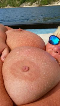 Suntanning on the boat today. by Cleavage3