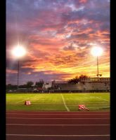 Needville Football Game Sunset by igaboo