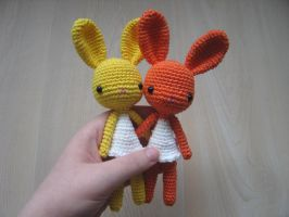 Toy #41 and #42 : yellow and orange bunny by Poolvos