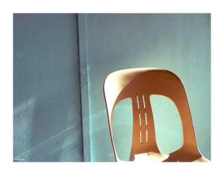 blue wall, beige chair. by thespook