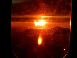 Sunset form an airplane window by thesmilyone