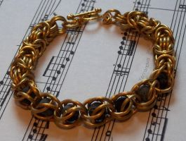 Captured gem chainmaille bracelet in gold by TerraNovaJewels