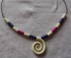 Glow in the dark spiral and bead necklace by MeticulousBlue