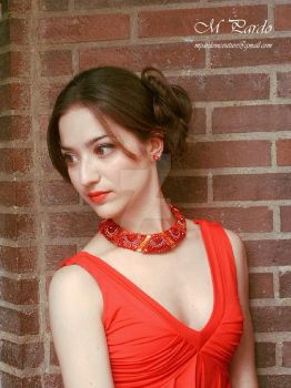 Bead embroidery neck piece in red and orange tones by arcticorset