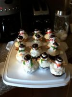 Snowman Cupcakes by MysticalMuffinTop