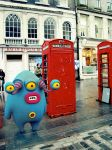 At a British phone booth by Cyberella74