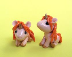 Orange Baby Unicorns by DragonsAndBeasties