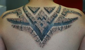 Stone tribal tattoo by Remistattoo