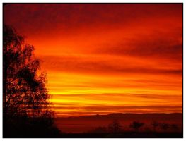 November sky is burning again by AriadneT