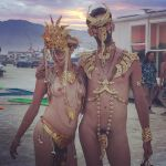 straight couple in gold at burning man  2 by TheMaleNudeStock