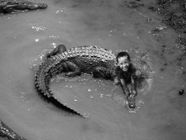 Child Playing With Crocodile by ctomuta