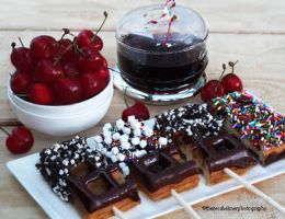Chocolate Belgium Waffles On  Sticks w/ Sprinkles by theresahelmer