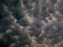 Mammatus Clouds by TheBirdsFeathers