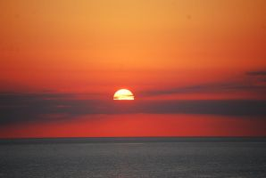 Sunset at sea by alain-angela