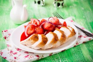 Grilled chicken breasts with fresh tomato salad by BeKaphoto