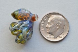 that is a dime....glass octopus by cold-in-the-north