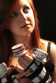 Alice and her tiny tea cups by VampirexxKissesxx