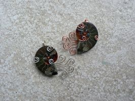 Whimsical Elder God Ammonites by magpie-poet