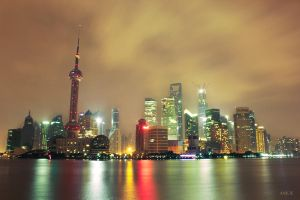 Shanghai skyline at night by anjoeaj