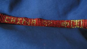 Completed CHN pride bracelet commission close up by Arachnoid