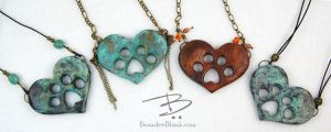 Paw-in-Heart Pendants by TinfoilHalo