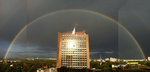 Rainbow with building by IcarusTyler