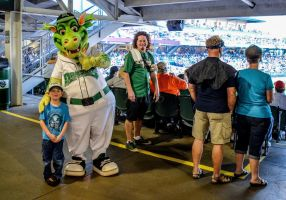 The kid at the dragons game by aspire2draw