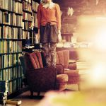 Standing in a bookshop by Holunder