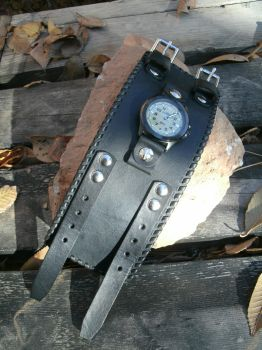 A wide black watch cuff by Mic-rez