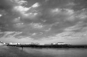 Clouds over the pier by Nigel-Kell