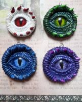 Dragon Eye Pendants by IronMaiden37