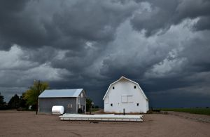 barn and approaching storm by eDDie-TK