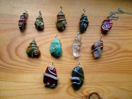 Set of Spiral Tumblestone Wrap pendants by crystalpanther2