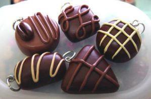 Chocolate charms by tragedienne