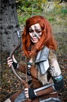 Aela sitting on log by MorgothiaCosplay