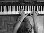 Playing the piano by NickKoutoulas