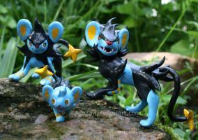 Luxray and his Family by Acc3a