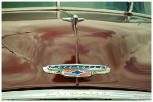 Hood Ornament And Badge On An Early 50's Chevy by TheMan268