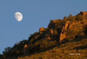 Moonrise Before Sunset by DavidMCoyle