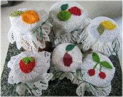 Knitted jam jar covers by buttercupminiatures