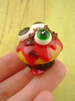 Yummy Eyeball Cupcake by monsterkookies