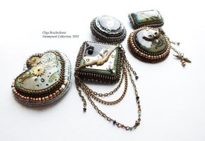 steampunk collection of brooches by othewhitewizard