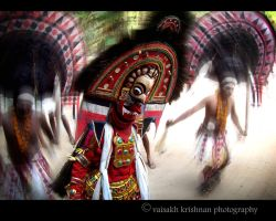 The Vibrant Poothan In Action by Krishography