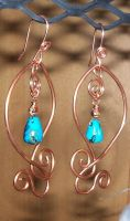 copper swirl earrings by artefaccio