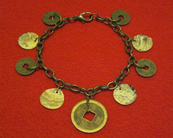 Lucky Coin Bracelet by BloodRed-Orchid