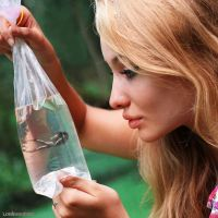 Woman holding newest pet by lowerrider