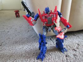 Optimus, with Orion's weapons by KrytenMarkGen-0