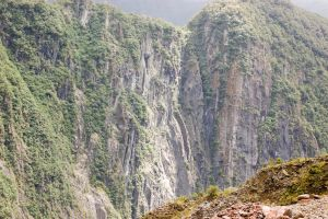 NZ big cliffs up hill foreground by Chunga-Stock